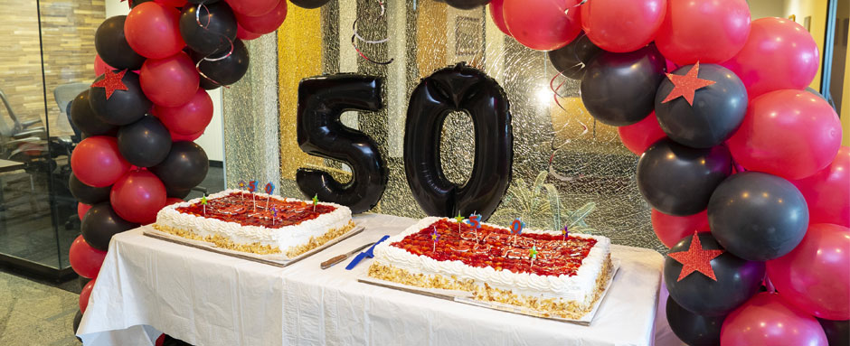 ALTRES celebrates 50 years of business in Hawaii with cake and balloons